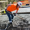 Mollie Currid, Pittsburg State student, works with concrete at the Ruby Jack Trail bridge on Tuesday.<br /> Globe | Roger Nomer