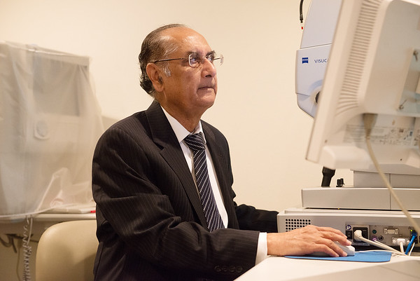 Ramesh Shah works with a scanner at his office in Joplin on Friday.<br /> Globe | Roger Nomer