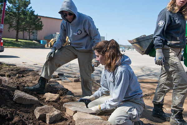 AmeriCorps National Civilian Community Corps members Benjamin Rott, West Palm Beach, Fla., and Paige O'Neil, Canandaigua, N.Y., work on a landscaping project at the Bluejacket Building in Seneca on Monday.<br /> Globe   Roger Nomer