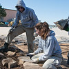 AmeriCorps National Civilian Community Corps members Benjamin Rott, West Palm Beach, Fla., and Paige O'Neil, Canandaigua, N.Y., work on a landscaping project at the Bluejacket Building in Seneca on Monday.<br /> Globe | Roger Nomer