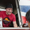 Neil Gowme takes an order from the London Calling food truck during Food Truck Friday in Carthage's Central Park.<br /> Globe | Roger Nomer