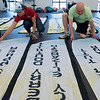 Ruth Sawkins, Joplin Memorial Run race director, and Audie Dennis work with banners for the Memorial Run at Freeman Rehab on Tuesday.<br /> Globe | Roger Nomer