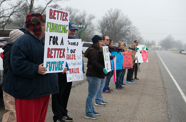 Commerce teachers and supporters protest along Mickey Mantle Boulevard on Monday during the walk out.<br /> Globe | Roger Nomer
