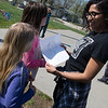 Martibel Payano, aka Marti Belle, receives a drawing from Sarayah Allen, 8, at the Joplin Boys and Girls Club on Thursday.<br /> Globe | Roger Nomer