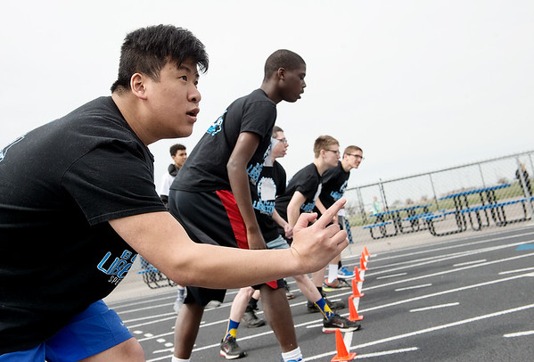 Doug Cochran, Boliver, watches in anticipation of the start of the 100-meter run during Wednesday's Special Olympics Missouri regional track and field meet at Haffner Stadium in Carthage.<br /> Globe | Roger Nomer