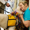 Susie Griffitt, Lamar, greets Gabrielle while staying in the hospital with her husband on Natonal Therapy Animal Day at Freeman West on Monday.<br /> Globe | Roger Nomer