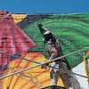 Yatika Fields, Tulsa, Okla., paints his mural as a tribute to indigenous women during Mural Fest 66 in downtown Miami on Saturday.<br /> Globe | Roger Nomer