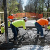 Pittsburg State University students and staff pour concrete at the Ruby Jack Trail bridge on Tuesday.<br /> Globe | Roger Nomer