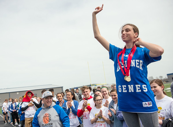 Megan Kocher, Clever, celebrates after receiving her medals during Wednesday's Special Olympics Missouri regional track and field meet at Haffner Stadium in Carthage.<br /> Globe | Roger Nomer