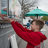 Morgan Vaughn, 12, Seneca, gets an order from Maggie's Curbside Cafe during Food Truck Friday in Carthage's Central Park.<br /> Globe | Roger Nomer
