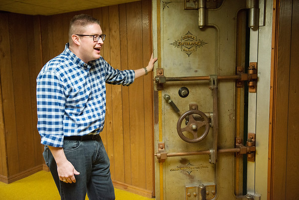Michael Patterson talks about the Miners Bank vault door during an interview on Friday.<br /> Globe   Roger Nomer