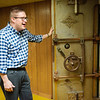 Michael Patterson talks about the Miners Bank vault door during an interview on Friday.<br /> Globe | Roger Nomer