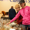 June Taylor, Miami, and her daughter Laurie Martin, Joplin, browse through a selection of dishes at the Neosho Christian School on Friday. The 30th annual Neosho Citywide Garage Sale continues on Saturday.<br /> Globe | Roger Nomer
