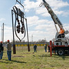 Workers install a Route 66 sign made by Riverton High students at the roundabout west of Riverton on Thursday morning.<br /> Globe | Roger Nomer