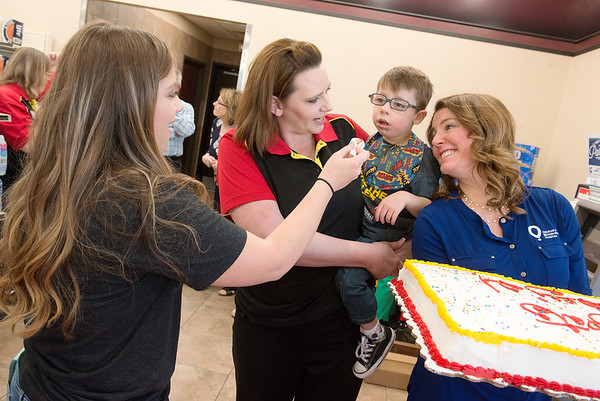 Brittany McCann ( left) and her son Kayden Dickerson, 4, celebrate with Mandi Frost, Casey's store manager, and Heather Lesmeister, program director for Children's Miracle Network, on Tuesday at the Casey's General Store on West 32nd. The event was a thank you party after the 44 local Casey's stores raised $66,475 for the Joplin Children's Miracle Network during their February Miracle Balloon Campaign. The West 32nd Casey's was first in the nation, raising $16,503.<br /> Globe | Roger Nomer