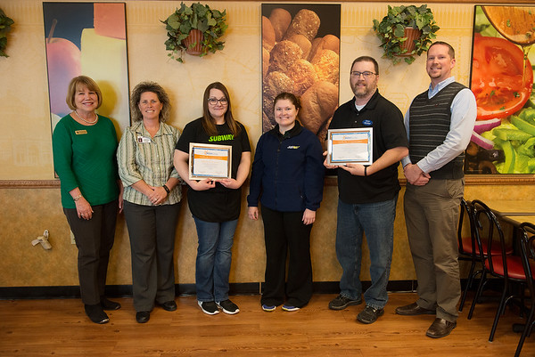 (from left) Peggy Fuller, board member of Bright Futures, Shally Lundien, principal of Columbia Elementary, Hannah Kaufmann, manager of Subway, Missina Sharp, operations manager of Subway, Chip Boyd, administrative pastor at Journey Church, and Jason Weaver, principal at Jefferson Elementary, attend the awarding of the Bright Futures Partner of the Month on Monday at the Subway at the West Seventh Street Walmart. Kaufmann was recognized for her work with Columbia Elementary, and Boyd was recognized for his work with Jefferson Elementary. Globe | Roger Nomer