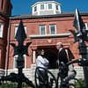 Stephanie Onstot, community relations associate with TAMKO, talks with Brad Belk, preservation director and curator with Joplin Historical Neighborhoods, in front of the Schifferdecker House on Monday.<br /> Globe | Roger Nomer