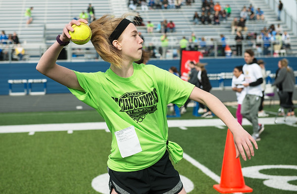 Cora Crowe, 13, East Newton, competes in the softball throw during Wednesday's Special Olympics Missouri regional track and field meet at Haffner Stadium in Carthage.<br /> Globe | Roger Nomer