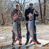 Kyle Green, left, and Jeff Hutchinson pose with their spoonbill catches on Wednesday in Fairland.<br /> Globe | Roger Nomer