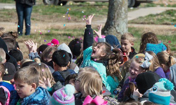 Goodman Elementary students toss confetti to celebrate the groundbreaking of thier new school on Wednesday in Goodman. Globe | Roger Nomer