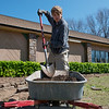 AmeriCorps National Civilian Community Corps member Paul Goehring, Seattle, Wash., works on a landscaping project at the Bluejacket Building in Seneca on Monday.<br /> Globe | Roger Nomer