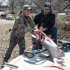 Kyle Green, left, and Jeff Hutchinson load their spoonbill catches on a boat on Wednesday in Fairland.<br /> Globe | Roger Nomer