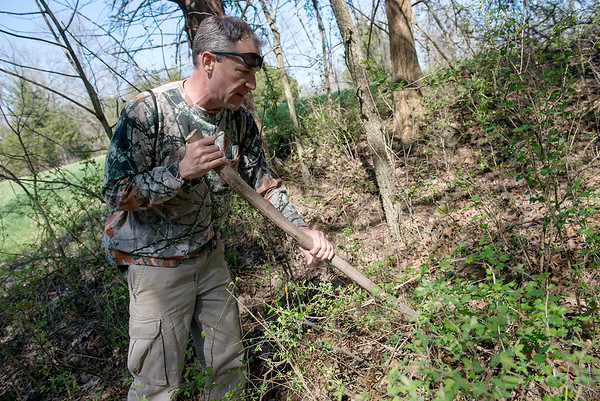 Nate Stokes searches for morels in Sarcoxie on Tuesday afternoon.<br /> Globe   Roger Nomer