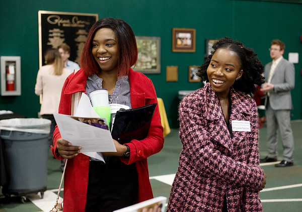 Henrietta Ehirim, a Cottey College senior from South Laurel, Md., left, and Phoebe Nache, a Cottey College senior from Eden Prairie, Minn., talk with representatives of Kansas City University of Medicine and Biosciences Joplin during Wednesday's spring career fair at Missouri Southern. Globe | Roger Nomer