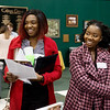 Henrietta Ehirim, a Cottey College senior from South Laurel, Md., left, and Phoebe Nache, a Cottey College senior from Eden Prairie, Minn., talk with representatives of Kansas City University of Medicine and Biosciences Joplin during Wednesday's spring career fair at Missouri Southern.<br /> Globe | Roger Nomer