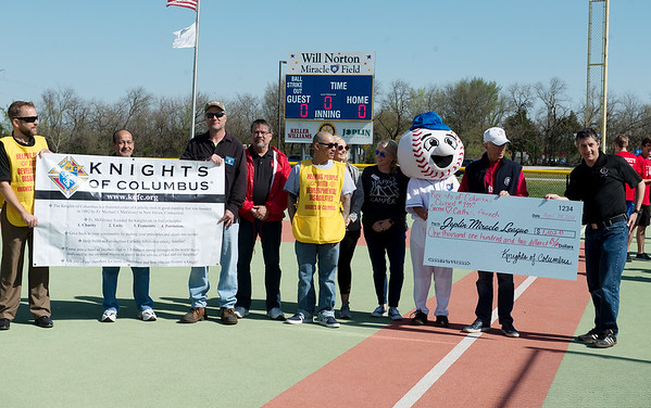 Members of the Knights of Columbus Council 7307 present a check for $1,102 to the Joplin Miracle League at the league's field on Saturday morning. The group raised the funds for the local charity from their annual fall Tootsie Roll Drive.<br /> Globe | Roger Nomer