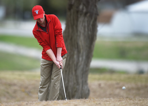 Nathan Ogden, a sophomore at Webb City High School, hits onto the green during Thursday's Joplin Invitational at Twin Hills.<br /> Globe   Roger Nomer