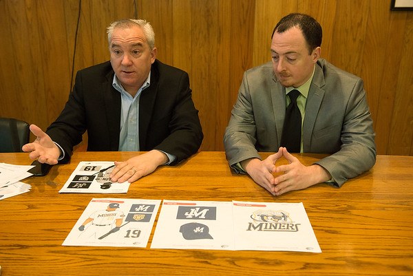 Mark Schuster, chief executive officer of the Ventura Sports Group, left, and Craig Puckett, part owner of the Joplin Miners, talk about the logo and uniforms of the team during an interview on Wednesday.<br /> Globe | Roger Nomer