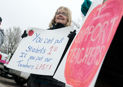 Kelly Wright, a kindergarten teacher at Alexander Elementary in Commerce, holds a sign during Monday's walk out. Globe   Roger Nomer