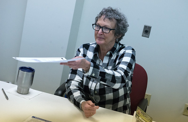 Sharon Burnett hands a ballot to a voter on Tuesday at the Joplin Association for the Blind. Globe | Roger Nomer