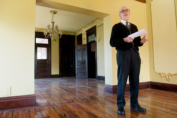 Brad Belk, preservation director and curator with Joplin Historical Neighborhoods, talks about the history and preservation of the Schifferdecker House on Monday.<br /> Globe | Roger Nomer