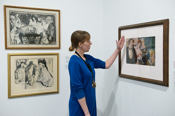 Sarah Buhr, curator, discusses some of Rose O'Neill's early illustrations on display at the Springfield Art Museum on Thursday.<br /> Globe | Roger Nomer