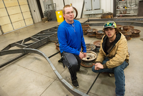 Riverton High seniors Tyler Gum, left, and Kenyon Clark talk about a Route 66 sign constructed by FFA students at the high school.<br /> Globe | Roger Nomer