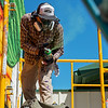 Yatika Fields tests a spray can while painting his mural in downtown Miami on Saturday during Mural Fest 66. <br /> Globe | Roger Nomer