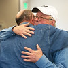 Jay Bible, left, hugs his first cousin Jim Bible following Monday's press conference in Vinita.<br /> Globe | Roger Nomer