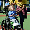 Six-year-old Adalyn Cates is all smiles as she is escorted to first base by Missouri Southern social work major Kayla Cosby during the Opening Day of Miracle League Baseball on Saturday morning at the Joplin Athletic Complex. Cosby was one of numerous MSSU students who volunteered Saturday at Will Norton Field.<br /> Globe | Laurie Sisk