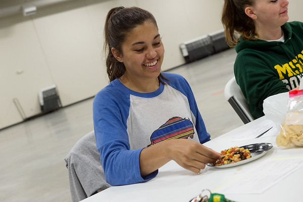 Emily Belden, a Missouri Southern junior from Nowata, Okla., tries a recipe for a canned bean salad on Monday at the Lion Co-op at Missouri Southern.<br /> Globe | Roger Nomer