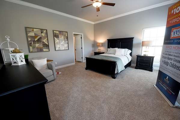 The large, master bedroom in the 2,600-sq ft. St. Jude's Dream Home, which will be raffled on May 22, sits staged with furniture at 1752 Kent Dr. in Webb City on Thursday. Tours of the $275,000 home will be offered from April 13to May 19. The house features four bedrooms and three bathrooms.<br /> Globe | Laurie Sisk
