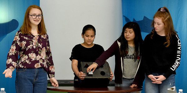 "From the left: Carthage Intermediate Center sixth graders Chloe Grissam, Kenzi Cooper, Karla Mendez and Kate Wagner present a prototype of their ""box of shapes"" during a ""Shark Tank "" themed ompetition aimed at designing toys for kids with cerebral palsy on Wednesday at CIC. . <br /> Globe 