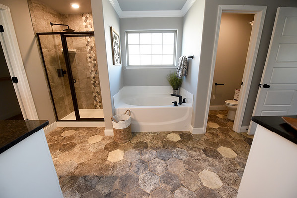 A master bath sits ready for use in the 2,600-sq ft. St. Jude's Dream Home, which will be raffled on May 22. Tours of the $275,000 home will be offered from April 13 to May 19. The house features four bedrooms and three bathrooms.<br /> Globe | Laurie Sisk