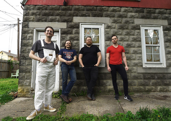 """Members of the popular rock band """"Me Like Bees"""" stand outside their rehearsal space on Thursday. The band has managed to balance both their work and band lives, performing multiple gigs. From the left: Bass player Jake Bennett, drummer Lewis Brossman and guitarists Luke Sheafer and Pete Burton. <br /> Globe 