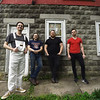 "Members of the popular rock band ""Me Like Bees"" stand outside their rehearsal space on Thursday. The band has managed to balance both their work and band lives, performing multiple gigs. From the left: Bass player Jake Bennett, drummer Lewis Brossman and guitarists Luke Sheafer and Pete Burton. <br /> Globe 
