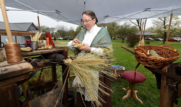 Granby's June Freund, of June's Brooms, fashions a handmade broom during the Fourth Annual Hammer In event on Saturday in Newtonia. The event featured Civil War reeanactors, blacksmiths, tours and more during the day-long event.<br /> Globe | Laurie Sisk