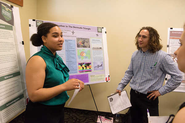 Autumn Roberts, a Missouri Southern senior from Springfield, Mo., and Lucas Hertzberg, a MSSU senior from Joplin, talk about their research during Wednesday's Student Research Symposium at MSSU.<br /> Globe   Roger Nomer