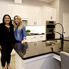 From the left: Sydney Watson, development representative for ALSAC/St. Jude's Children's Research Hospital and Angie Schuber, of Schuber Mitchell Homes, stand inside the large kitchen of the 2,600-sq ft. St. Jude's Dream Home, which will be raffled on May 22. Tours of the $275,000 home will be offered from April 13 to May 19. The house also features four bedrooms and three bathrooms.<br /> Globe | Laurie Sisk