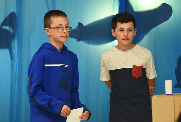 """Twins Colt and Dylan Pugh answer questions from judges about a prototype of their winning design of a """"sound box"""" toy during a """"Shark Tank"""" themed competition aimed at designing toys for kids with cerebral palsy on Wednesday at CIC. . Entries were judged on a number of factors, including creativity and therapeutic use.<br /> Globe 